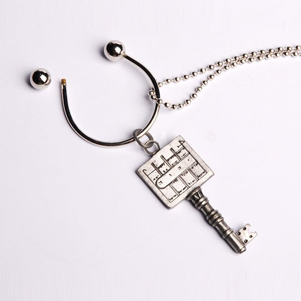 Key-holder-with-Pewter-Seal-for-Inc--Chain---Paths-Clearing